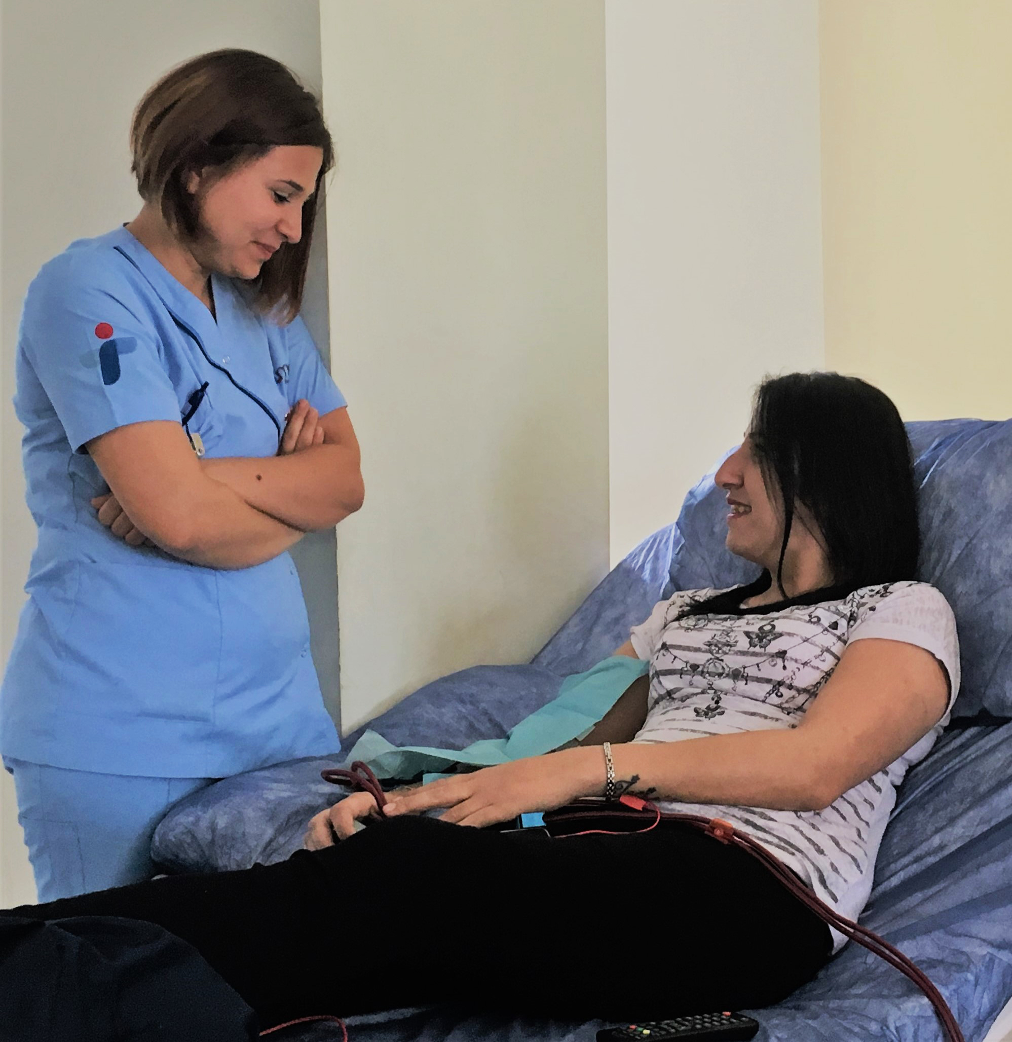 Hilal, a dialysis patient being treated by a nurse working at D.med healthcare.